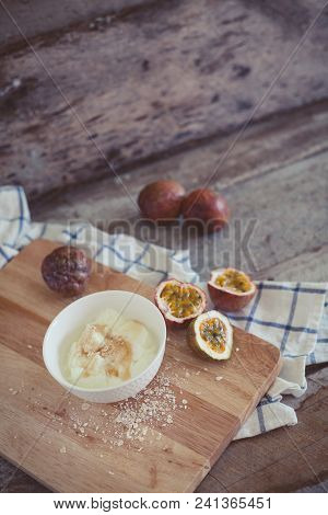 Healthy Rural Breakfast With Yogurt And Exotic Passion Fruit On Wooden Background. Cut Passion Fruit