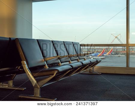 San Francisco, Ca - May 10, 2018: Empty Seats At Sfo Airport With Southwest Planes In Background