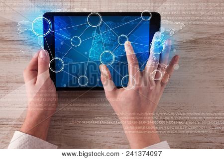 Caucasian business hands working on tablet.