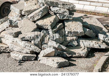 Big Pile Of Old Asphalt Road Debris Damaged Piling Up On The Ground
