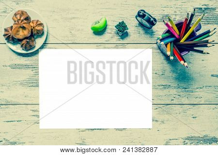 Colored Multicolored Pencils, A Sheet Of White Paper Isolated, Old Style Clock, Plate With Cake On A