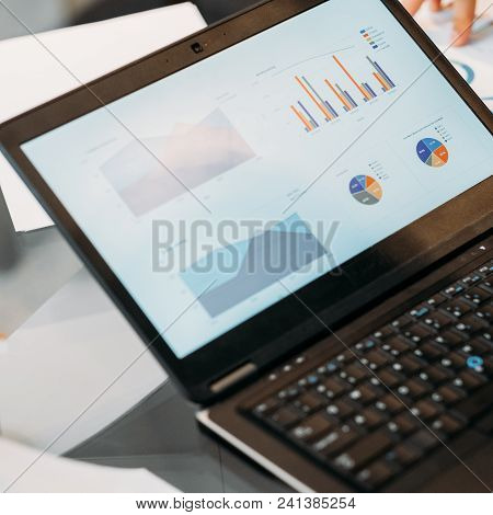 Information And Technology In Business Concept. Diagram, Graph, Chart And Statistics Data On A Lapto