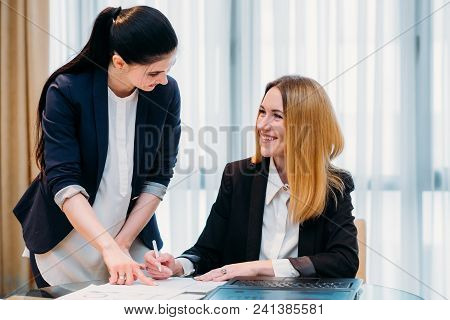 Secretary Job. Professional Duties. Young Employee Assisting Her Boss In Signing Documents. Good Wor