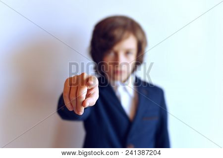 Schoolboy With Outstretched Hands On A White Background, Hand In Sharpness