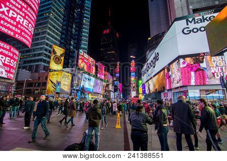 New York, Us - March 30, 2018: View Of People Visiting The Famous Times Square In New York At Night