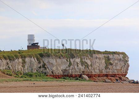 Lighthouse On The Cliffs Above Old Hunstanton Beach, Norfolk