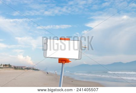 Selfie Photo Concept : Mock Up Extensible Selfie Stick Or Monopod With Mobile Phone Taking Picture S
