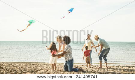 Group Of Happy Families With Parent And Children Playing With Kite At Beach Vacation - Summer Joy Ca