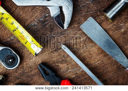 Different Construction Tools With Hand Tools For Home Renovation On Wooden Board Maintenance And Rep