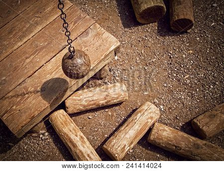 Ball On Chain Breaking Wooden Cylinders. Concept: Relations Destruction, Unforeseen Circumstances, B