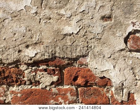 Old Crashed Brick Wall Texture. Grunge Ancient Architecture Surface. Vintage Textured Concrete Mater