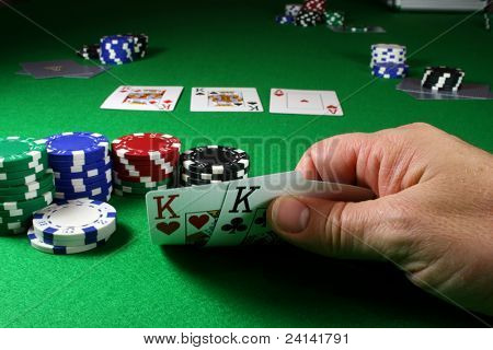 The Game - Pocket Kings deep DOF, showing the flop of 2 Kings clearly.