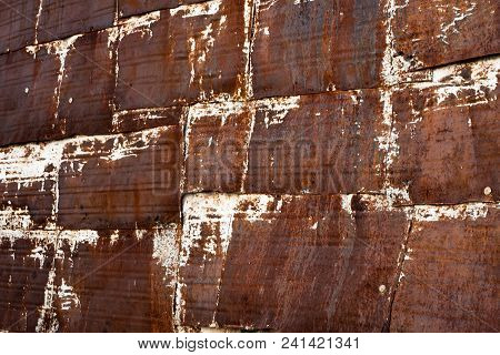 Heavily Rusted Squares Of Sheet Metal Constructed As A Wall