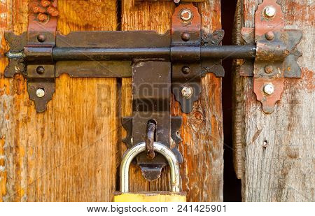 Vintage Lock On A Rusty Loop On A Wooden Background, Copy Space,closeup, Concept Of Authentic Object