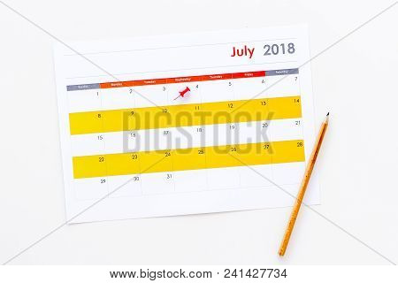 Planning. Point The Date In Calendar By Pushpin. Set The Goal. Choose Date. Calendar On White Backgr