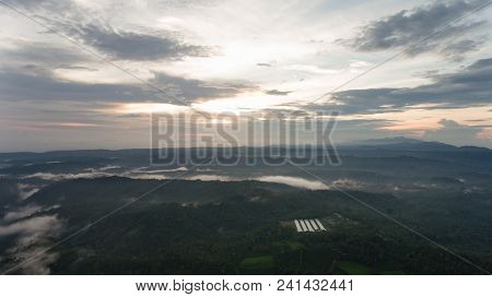 Aerial View Of Forest, Mountains With Fog, Clouds At Sunset On Bali, Indonesia. Tropical Rainforest,