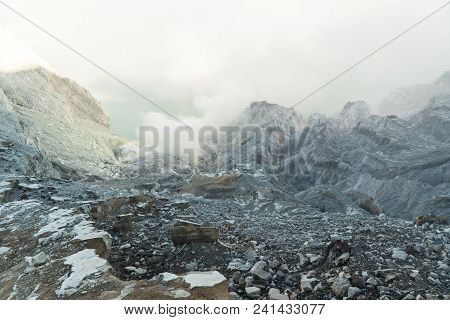 Extraction Of Sulfur In The Crater Of A Volcano. Sulfur Gas, Smoke. Kawah Ijen, Crater With Acidic C