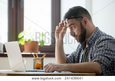 Shocked Frustrated Male Staring At Laptop Screen, Upset With Bad Online News, Company Business Colla