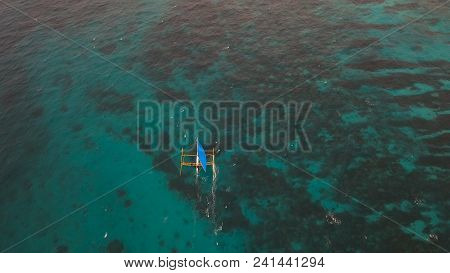 Sailing Boat In Blue, Turquoise Lagoon. Sailing Ship Yachts With Blue Sails In The Ocean.aerial View