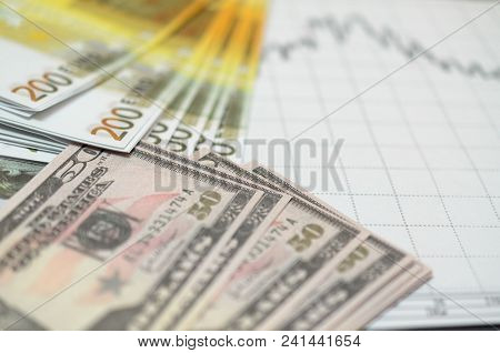 Money Against The Background Of Financial Stock Charts