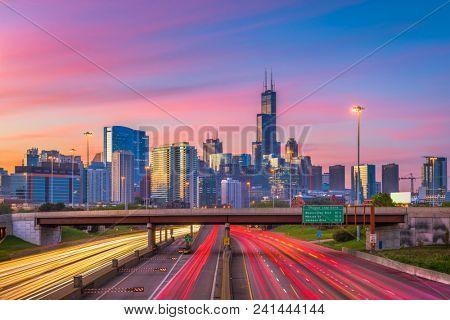 Chicago, Illinois, USA downtown skyline over highways at twilight.