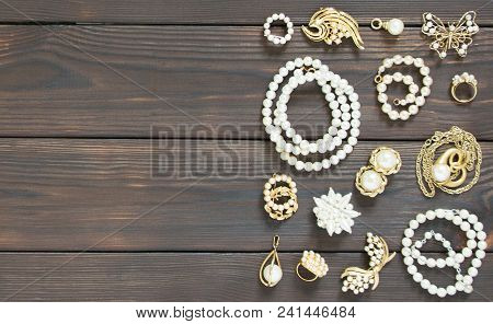 Woman's Jewelry. Vintage Jewelry Background. Beautiful Pearl Brooches, Braceletes, Necklaces And Ear