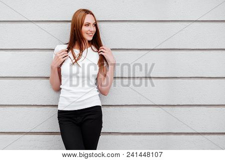 Girl Wearing Blank White T-shirt, Jeans Posing Against Rough Street Wall, Minimalist Urban Clothing