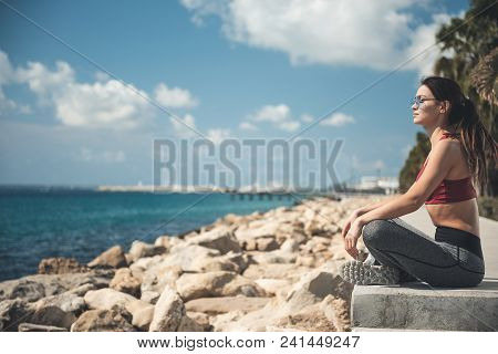 Full Length Side View Calm Lady Meditating On Coast. She Enjoying Sea Air. Peace In Soul Concept