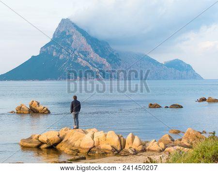 San Teodoro, Sardinia Italy - May 8 2018: Beautiful Shallow Blue Water Bay Overlooking Isola Tavara