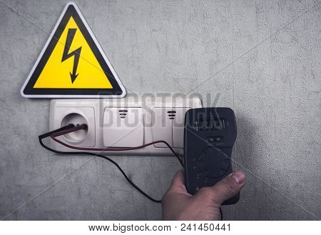 The Electrician Makes Electrical Measurements; Jumps Tension, Electrical Safety.