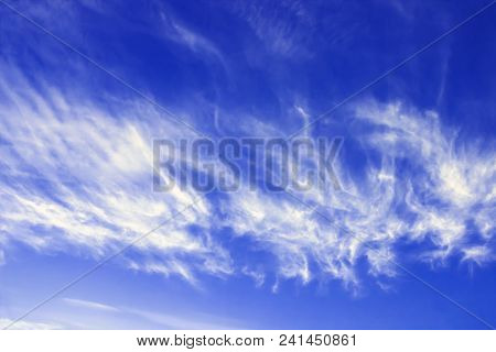 Cirrus Fibratus, Cirrus Clouds In Latin Language. Cloud Formation, Background With Blue Sky And Cirr