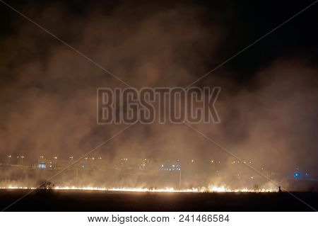 The Smoke From The Burning Field, Fire In The Field At Night, Burning Grass On The Field