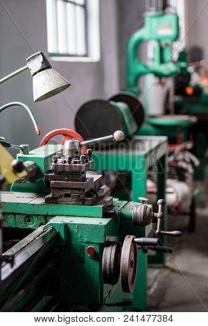 Old Hard Lathe In A Workshop. Machine Park In The Locksmith's Workshop.