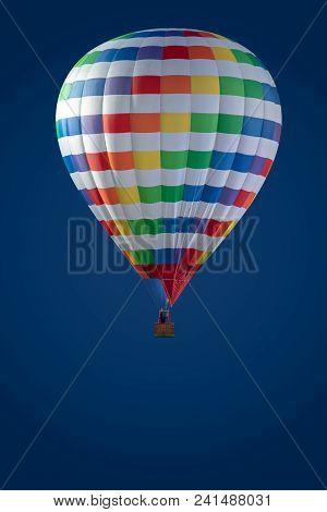 Hot Air Balloon In Blue Sky. Colourfull Hot Air Balloon Isolated On Blue Background. Colourfull Ball
