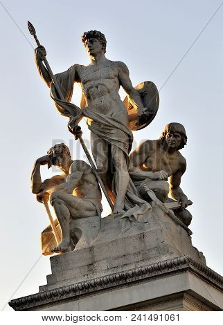 Guardians: Stone Sculpture On Top Of Building In Rome, Italy