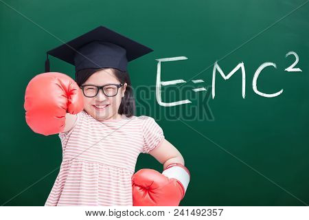 Cute Girl Wear Bachelor Cap With Glove And E=mc2 On Green Chalkboard