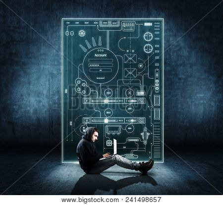 Man Working On Laptop In Front Of Digital Layout.