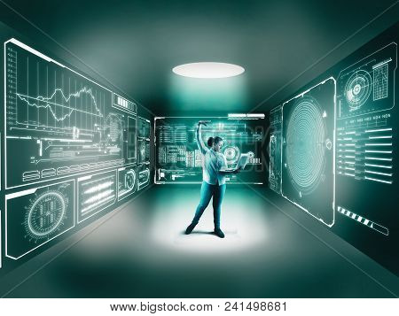 Woman Using A Laptop In The Middle Of A Room With Digital Screen Holograms On Walls.