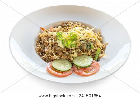Fried Rice Nasi Goreng With Chicken And Vegetables On A Plate. Indonesian Cuisine