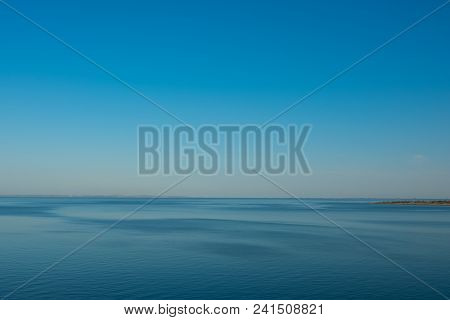 Beautiful Seascape. Calm Sea, Ocean On A Background Of Blue Sky. Tranquil Sea Harmony Of Calm Water