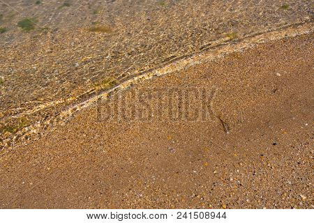 Clear Clear Sea Water. Sun Light And Clear Sea Water Texture Background. Abstract Water Background.