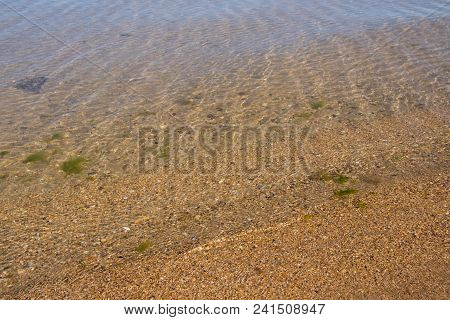 Clear Clear Sea Water. Sun Light And Clear Sea Water Texture Background