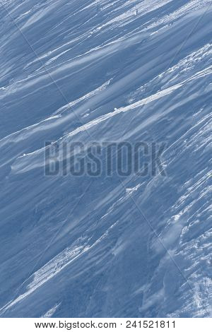 Portrait Format View Of Ridges Forming Oblique Lines In Wind Packed Snow