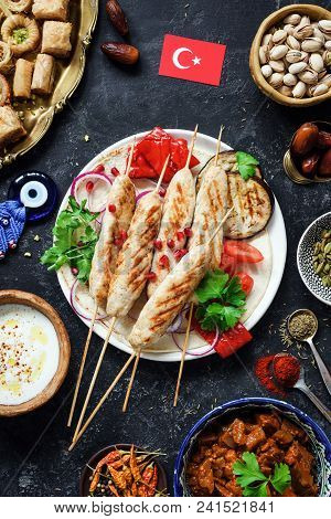 Traditional Turkish Kebab Or Kabob, Turkish Sweets, Yogurt Sauce And Roasted Vegetables. Turkish Foo