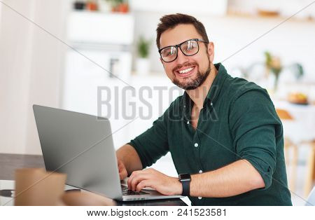 Happy Man Businessman, Freelancer, Student Working At Computer At Home And Office