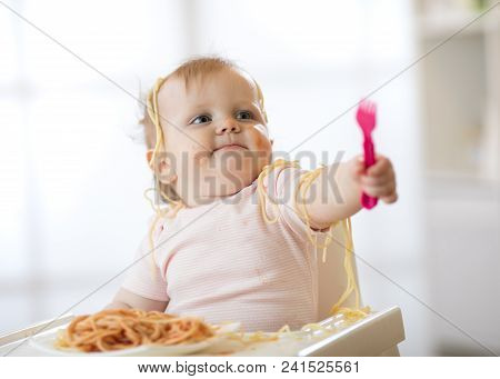 Little Baby Toddler Eating Her Pasta And Making A Mess