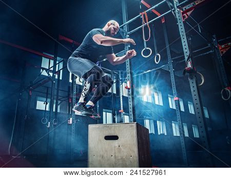 Man Jumping During Exercises In The Fitness Gym. Crossfit Concept. Gym, Sport, Rope, Training, Athle