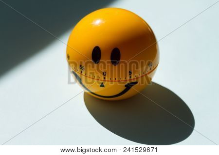 Yellow Smiley Face Circle Ball On A Blue Background, Top View. Shadow From The Sun. Happy Work Day C
