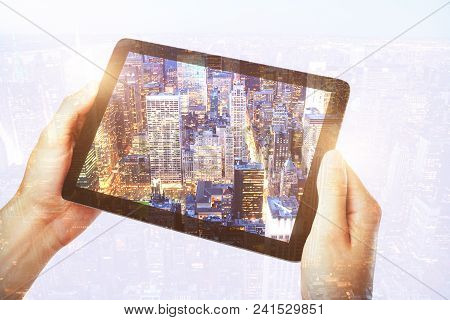 Hand Taking Picture Of City With Touchpad. Photography And Art Concept. Double Exposure