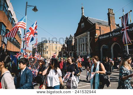 Windsor, United Kingdom - May 19 2018: A Man Sell Uk And Usa Flags As Well-wishers Move Along Street